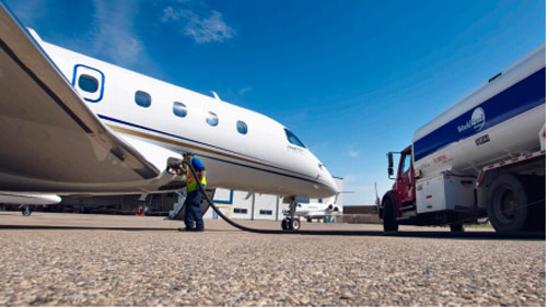 Skyservice Sustainable Aviation Fuel Truck filling up Aircraft